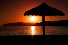 Paraguas de la puesta del sol Foto de archivo