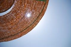 Paraguas de Sun en la playa Imagen de archivo libre de regalías