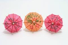 Paraguas de tres cocteles Imágenes de archivo libres de regalías