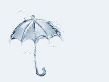 Paraguas del agua azul Imágenes de archivo libres de regalías