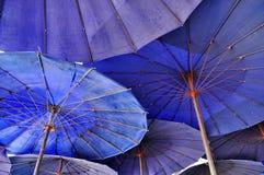 Paraguas del azul de la coincidencia Imagen de archivo libre de regalías