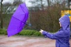 Paraguas en el viento Fotografía de archivo libre de regalías