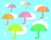 Paraguas en la lluvia ilustración del vector