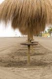 Paraguas en la playa Imágenes de archivo libres de regalías