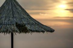 Paraguas en la puesta del sol Foto de archivo