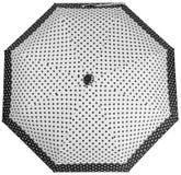 Paraguas punteado blanco y negro Visi?n superior imagenes de archivo