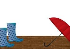Paraguas rojo y botas azules Imagen de archivo
