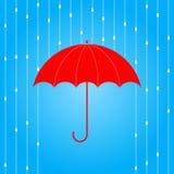 Paraguas y lluvia rojos Imagenes de archivo