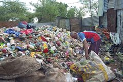Recycling plastic bottles as a survival strategy. Paraguay, capital, city Asuncion: In slum, Banjado Sur people live from the rubbish dump. They sort out stock image