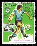 Uruguayan national team. Paraguay - CIRCA 1980: Stamp printed by Portugal, Multicolor offset edition on topic of Spain World Football Cup 1988, shows football Royalty Free Stock Image