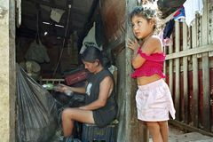 Poverty and recycling in Paraguayan slum. Paraguay, city Asuncion: Daily life in the slum, Barrio Chacarita, in the center of the capital. Woman must earn her Royalty Free Stock Photos