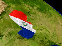 Paraguay with flag on Earth Stock Photo