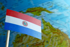 Paraguay flag with a globe map as a background Royalty Free Stock Images