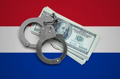 Paraguay flag with handcuffs and a bundle of dollars. Currency corruption in the country. Financial crimes royalty free stock photography