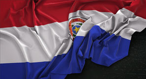 Paraguay-Flagge knitterte auf dunklem Hintergrund 3D übertragen Lizenzfreies Stockfoto