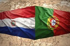 Paraguay and Portugal. Waving Paraguayan and Portuguese flags on the of the political map of the world Royalty Free Stock Photo