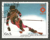 Olympics in Sarajevo, Max Julen. Paraguay - stamp 1984, Multicolor Air Mail Edition, Winter sports, Olympic Games Slalom, Series Winner of the Winter Olympics in royalty free stock photo