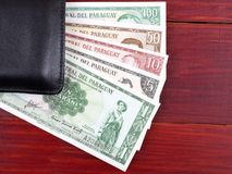 Paraguayan money in the black wallet Royalty Free Stock Image