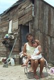 Paraguayan mother and child live in great poverty. Paraguay, capital, city Asuncion: Young woman with her daughter in front of their house in the slum Banjado stock photo