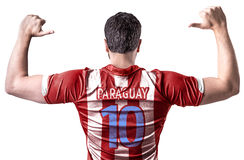 Paraguayan soccer player celebrating on white background Royalty Free Stock Image