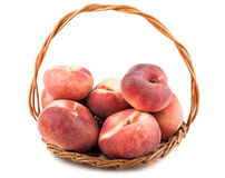 Paraguayos flat peaches in wicker basket Royalty Free Stock Photos