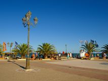 Paralia Katerinis, Greece - Tourists relaxing on the promenade by the sea royalty free stock photo
