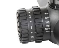 Parallax and reticle brightness know. Parallax and reticle brightness knob on a sniper scope royalty free stock photo