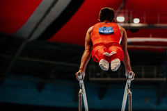 Parallel bars exercise. Athlete gymnast to competition in gymnastics Royalty Free Stock Images