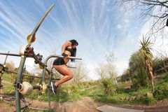 Parallel bars girl. Young sporty fitness woman at the parallel bars Stock Image