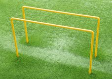 Parallel bars. On an AstroTurf pitch used for exercise and fitness royalty free stock photo