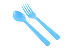 Parallel blue plastic spoon and fork Royalty Free Stock Photo
