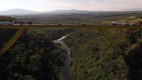 Parallel bridge and horizon aerial view stock video