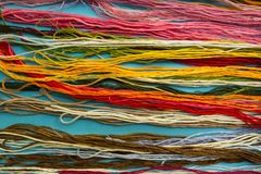 Parallel colorful cotton embroidery floss background, threads for needle craft close up stock image