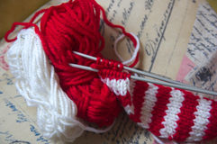 Parallel knitting needles with two balls Royalty Free Stock Photography