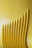 Parallel lines. Sinuous parallel lines in yellow plastic Stock Image