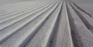 Parallel Lines in Concrete Toward a Horizon Optical illusion. The image shows parallel lines in concrete. There is interest of texture, light and shadow. It royalty free stock photo