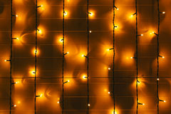 The parallel lines of garlands on the wall Royalty Free Stock Image