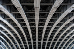 Parallel steel beams supporting bridge span. Detail of riveted steel beams supporting span of bridge crossing the River Thames Stock Image