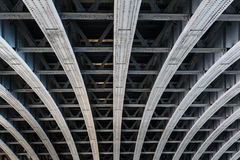 Parallel steel beams supporting bridge span. Detail of riveted steel beams supporting span of bridge crossing the River Thames Royalty Free Stock Photography