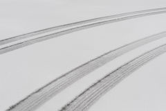 Parallel tire tracks in the snow Stock Photos