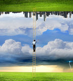 Parallel worlds. Businessman standing on ladder between two realities Stock Photo