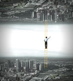Parallel worlds. Businessman standing on ladder between two realities Royalty Free Stock Image