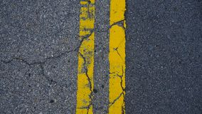 A parallel yellow lines on the floor stock photos