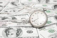 parallellla affärsidédollar överhopar tid för timmepengarpapper Arkivbilder