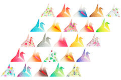 Parallelogram birds. Paper folded birds arranged in a parallelogram shape and isolated on a white background Stock Photography