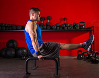 Parallettes man parallel bars workout at gym. Parallettes man parallel bars workout exercise at red gym stock photos