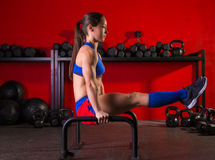 Parallettes woman parallel bars workout at gym Stock Photo