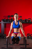 Parallettes woman parallel bars workout at gym Royalty Free Stock Photos
