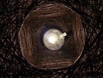 Paralume attorcigliato interno della lampadina Immagine Stock
