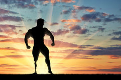 Paralympic bodybuilder with prosthetic leg sunset. Paralympic disabled bodybuilder with prosthesis on her leg is in pose on sunset. Concept handicapped and sport Stock Photography